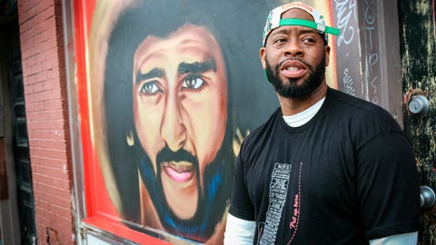 "<p>               Artist Fabian ""Occasional Superstar"" Williams stands in front of a Colin Kaepernick-themed mural on Monday, Feb. 4, 2019, in Atlanta. Several such murals were hastily painted over the weekend across the Super Bowl host town in protest after one that had stood for two years was abruptly demolished on the eve of the big game. (AP Photo/ Ron Harris)             </p>"