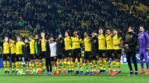 <p>               Dortmund's players celebrate after winning the German Bundesliga soccer match between Borussia Dortmund and Bayer Leverkusen in Dortmund, Germany, Sunday, Feb. 24, 2019. Dortmund defeated Leverkusen with 3-2. (AP Photo/Martin Meissner)             </p>