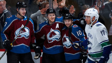 <p>               Colorado Avalanche center Nathan MacKinnon, second from left, is congratulated after scoring a goal by, from left, defenseman Ryan Graves and right wing Sven Andrighetto as Vancouver Canucks left wing Josh Leivo passes by in the first period of an NHL hockey game Wednesday, Feb. 27, 2019, in Denver. (AP Photo/David Zalubowski)             </p>