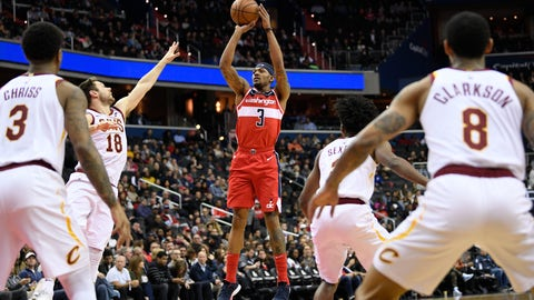 <p>               Washington Wizards guard Bradley Beal (3) shoots against Cleveland Cavaliers forward Marquese Chriss (3 ), guard Matthew Dellavedova (18), guard Collin Sexton (2) and guard Jordan Clarkson (8) during the first half of an NBA basketball game Friday, Feb. 8, 2019, in Washington. (AP Photo/Nick Wass)             </p>