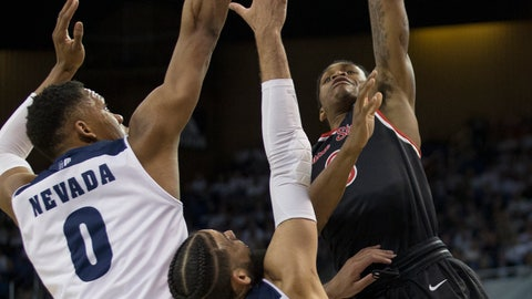 <p>               Fresno State guard New Williams (0) shoots over the arms of Nevada forward Tre'Shawn Thurman (0) and forward Cody Martin (11) in the first half of an NCAA college basketball game in Reno, Nev., Saturday, Feb. 23, 2019. (AP Photo/Tom R. Smedes)             </p>