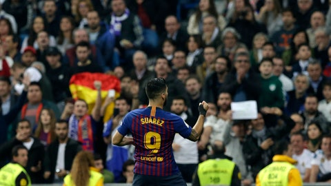 <p>               Barcelona forward Luis Suarez celebrates after scoring his side's opening goal during the Copa del Rey semifinal second leg soccer match between Real Madrid and FC Barcelona at the Bernabeu stadium in Madrid, Spain, Wednesday Feb. 27, 2019. (AP Photo/Andrea Comas)             </p>