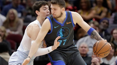 <p>               Dallas Mavericks' Luka Doncic (77), from Slovenia, drives past Cleveland Cavaliers' Cedi Osman (16), from Turkey, in the first half of an NBA basketball game, Saturday, Feb. 2, 2019, in Cleveland. (AP Photo/Tony Dejak)             </p>
