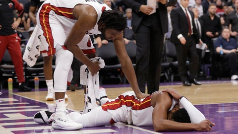 <p>               Miami Heat forward Justise Winslow, left, checks on teammate Dwyane Wade, who hit his head after a hard landing during the first quarter of the team's NBA basketball game against the Sacramento Kings. Friday, Feb. 8, 2019, in Sacramento, Calif. (AP Photo/Rich Pedroncelli)             </p>