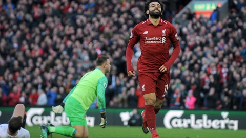 <p>               Liverpool's Mohamed Salah celebrates after scoring his side's third goal during the English Premier League soccer match between Liverpool and AFC Bournemouth at Anfield stadium in Liverpool, England, Saturday, Feb. 9, 2019. (AP Photo/Rui Vieira)             </p>