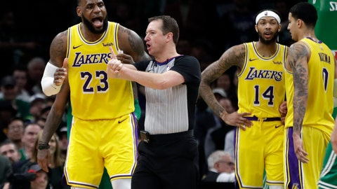 <p>               Los Angeles Lakers forward LeBron James (23) argues a call with the referee as Lakers forwards Brandon Ingram (14) and Kyle Kuzma (0) talk to each other in the fourth quarter of an NBA basketball game against the Boston Celtics, Thursday, Feb. 7, 2019, in Boston. (AP Photo/Elise Amendola)             </p>