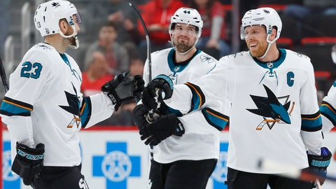 <p>               San Jose Sharks center Joe Pavelski, right, celebrates his empty net goal with Barclay Goodrow (23) in the third period of an NHL hockey game against the Detroit Red Wings, Sunday, Feb. 24, 2019, in Detroit. Pavelski scored three goals in the Sharks' 5-3 win. (AP Photo/Paul Sancya)             </p>
