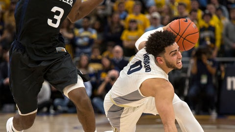 <p>               Marquette's Marcus Howard, right, slips as he drives past Butler's Kamar Baldwin, left, during the first half of an NCAA college basketball game Wednesday, Feb. 20, 2019, in Milwaukee. (AP Photo/Darren Hauck)             </p>