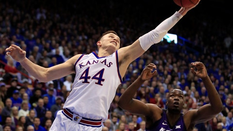 <p>               Kansas forward Mitch Lightfoot (44) rebounds over Kansas State forward Makol Mawien (14) during the second half of an NCAA college basketball game in Lawrence, Kan., Monday, Feb. 25, 2019. (AP Photo/Orlin Wagner)             </p>