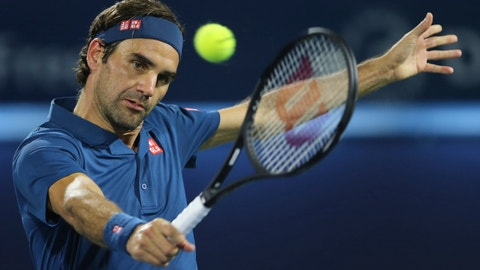 <p>               Roger Federer of Switzerland returns the ball to Fernando Verdasco of Spain during their match at the Dubai Duty Free Tennis Championship, in Dubai, United Arab Emirates, Wednesday, Feb. 27, 2019. (AP Photo/Kamran Jebreili)             </p>