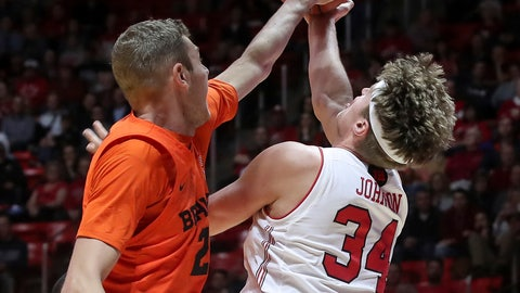 <p>               Utah center Jayce Johnson (34) is fouled by Oregon State forward Kylor Kelley (24) while shooting during the second half of an NCAA college basketball gamep Saturday, Feb. 2, 2019, in Salt Lake City. Oregon State won 81-72. (AP Photo/Chris Nicoll)             </p>