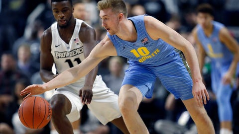 <p>               Marquette's Sam Hauser (10) battles Providence's Alpha Diallo (11) for a loose ball during the first half of an NCAA college basketball game in Providence, R.I., Saturday, Feb. 23, 2019. (AP Photo/Michael Dwyer)             </p>