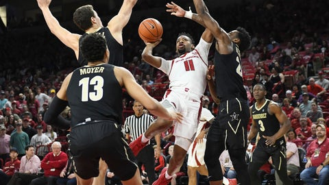 <p>               Arkansas guard Keyshawn Embery-Simpson (11) tries to get past Vanderbilt defenders Matthew Moyer (13), Yanni Wetzell, (1) and Aaron Nesmith (24) during the first half of an NCAA college basketball game, Tuesday, Feb. 5, 2019 in Fayetteville, Ark. (AP Photo/Michael Woods)             </p>
