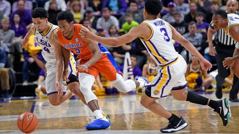 <p>               LSU guard Skylar Mays (4), Florida guard KeVaughn Allen (5) and LSU guard Tremont Waters (3) chase the ball in overtime of an NCAA college basketball game Wednesday, Feb. 20, 2019, in Baton Rouge, La. Florida won 82-77. (AP Photo/Bill Feig)             </p>