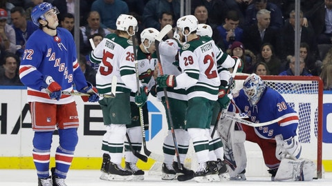 <p>               New York Rangers' Filip Chytil, left, and goaltender Henrik Lundqvist, right, react as as the Minnesota Wild celebrate a goal by Mikael Granlund during the second period of an NHL hockey game Thursday, Feb. 21, 2019, in New York. (AP Photo/Frank Franklin II)             </p>