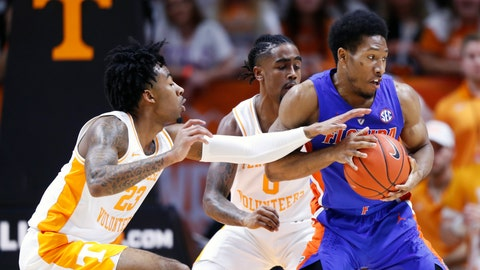 <p>               Florida guard KeVaughn Allen, right, is pressured by Tennessee guards Jordan Bowden (23) and Jordan Bone (0) during the first half of an NCAA college basketball game, Saturday, Feb. 9, 2019, in Knoxville, Tenn. (AP photo/Wade Payne)             </p>
