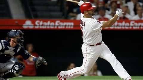 """<p>               FILE - In this July 10, 2018, file photo, Los Angeles Angels' Albert Pujols, right, watches his three-run home run in front of Seattle Mariners catcher Chris Herrmann during the fourth inning of a baseball game in Anaheim, Calif. Pujols has a bold if unrealistic prediction for his 2019 season. """"I'm expecting to play 162 games,"""" the Angels first baseman said Sunday, Feb. 17, 2019. (AP Photo/Alex Gallardo, File)             </p>"""