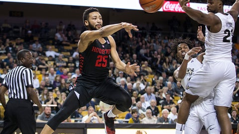 <p>               Houston guard Galen Robinson Jr. (25) passes the ball on Central Florida's guard Xavier Grant (12) during the first half of an NCAA college basketball game in Orlando, Fla., Thursday, Feb. 7, 2019. (AP Photo/Willie J. Allen Jr.)             </p>