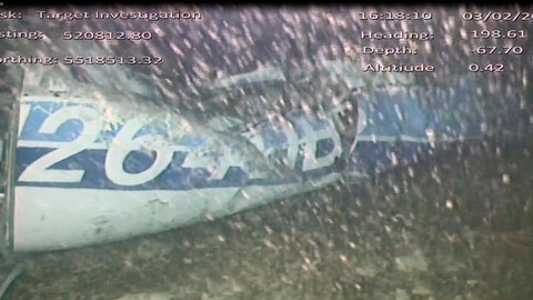 <p>               In this image released Monday Feb. 4, 2019, by the UK Air Accidents Investigation Branch (AAIB) showing the rear left side of the fuselage including part of the aircraft registration N264DB that went missing carrying soccer player Emiliano Sala, when it disappeared from radar contact on Jan. 21 2019.  The Air accident investigators say one body is visible in the sea in the wreckage of the plane that went missing carrying soccer player Emiliano Sala and his pilot David Ibbotson. (AAIB via AP)             </p>