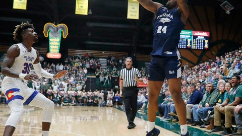 <p>               Nevada forward Jordan Caroline, right, shoots a 3-pointer over Colorado State guard Kris Martin during the first half of an NCAA college basketball game Wednesday, Feb. 6, 2019, in Fort Collins, Colo. (AP Photo/David Zalubowski)             </p>