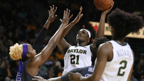 <p>               Baylor center Kalani Brown, right, scores over TCU center Jordan Moore, left, in the second half of an NCAA college basketball game, Saturday, Feb. 9, 2019, in Waco, Texas. Baylor won 89-71. (AP Photo/Rod Aydelotte)             </p>