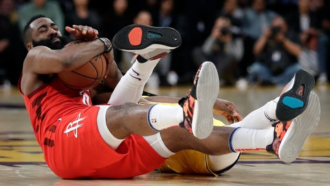 <p>               Houston Rockets' James Harden, left, reaches for a loose ball next to Los Angeles Lakers' Reggie Bullock during the second half of an NBA basketball game Thursday, Feb. 21, 2019, in Los Angeles. (AP Photo/Marcio Jose Sanchez)             </p>