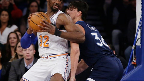 <p>               New York Knicks' Noah Vonleh (32) is defended by Minnesota Timberwolves' Dario Saric (36) during the first half of an NBA basketball game Friday, Feb. 22, 2019, in New York. (AP Photo/Frank Franklin II)             </p>