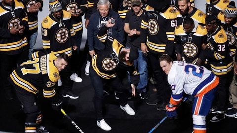 <p>               Super Bowl MVP and New England Patriots wide receiver Julian Edelman, center, spikes the puck during the ceremonial face-off between Boston Bruins center Patrice Bergeron (37) and New York Islanders left wing Anders Lee (27) prior to the first period of an NHL hockey game in Boston, Tuesday, Feb. 5, 2019. (AP Photo/Charles Krupa)             </p>