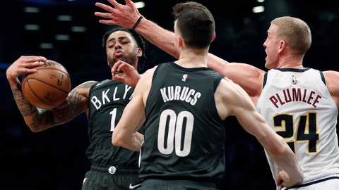 <p>               Brooklyn Nets guard D'Angelo Russell (1) pulls down a rebound in front of Denver Nuggets forward Mason Plumlee (24) as Nets forward Rodions Kurucs (00) watches during the first half of an NBA basketball game Wednesday, Feb. 6, 2019, in New York. (AP Photo/Kathy Willens)             </p>