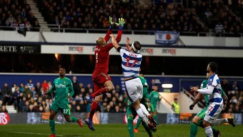 <p>               Watford's goalkeeper Heurelho Gomes, second left, collects the ball past Queens Park Rangers' Matt Smith during the English FA Cup 5th round soccer match between Queens Park Rangers and Watford at Loftus Road stadium in London, Friday, Feb. 15, 2019. (AP Photo/Alastair Grant)             </p>