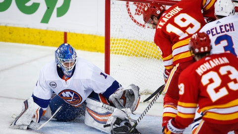 <p>               New York Islanders goalie Thomas Greiss, left, of Germany, stops a shot from Calgary Flames' Matthew Tkachuk during the second period of an NHL hockey game Wednesday, Feb. 20, 2019, in Calgary, Alberta. (Jeff McIntosh/The Canadian Press via AP)             </p>