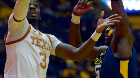 <p>               Texas guard Courtney Ramey (3) goes for a layup as West Virginia forward Lamont West (15) tries to block during the first half of an NCAA college basketball game in Morgantown, W.Va., Saturday, Feb. 9, 2019. (AP Photo/Craig Hudson)             </p>