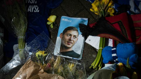 <p>               Tributes are placed outside the Cardiff City Stadium, Wales, for Emiliano Sala, Friday Feb. 8, 2019. Tributes are being paid across soccer to Argentine player Emiliano Sala, with the French league announcing a minute's applause before matches. French club Nantes says it will retire the No. 9 jersey worn by Sala before he was sold last month to Cardiff in the English Premier League. (Aaron Chown/PA via AP)             </p>