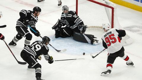 <p>               Ottawa Senators center Matt Duchene (95) is defended by Chicago Blackhawks Jonathan Toews (19), Duncan Keith (2) and goaltender Cam Ward (30) during the third period of an NHL hockey game Monday, Feb. 18, 2019, in Chicago. The Blackhawks won 8-7. (AP Photo/Jeff Haynes)             </p>