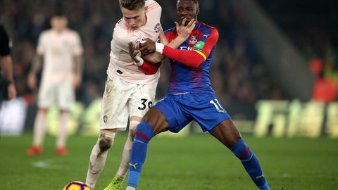 <p>               Manchester United's Scott McTominay, left, in action with Crystal Palace's Wilfried Zaha, during the English Premier League soccer match at Selhurst Park in London, Wednesday Feb. 27, 2019. (John Walton/PA via AP)             </p>