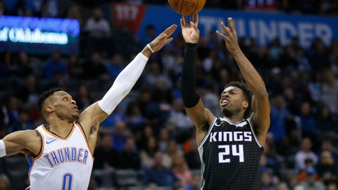 <p>               Sacramento Kings guard Buddy Hield (24) shoots in front of Oklahoma City Thunder guard Russell Westbrook (0) during the first half of an NBA basketball game in Oklahoma City, Saturday, Feb. 23, 2019. (AP Photo/Sue Ogrocki)             </p>