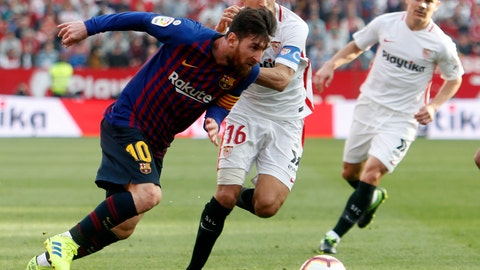<p>               Barcelona forward Lionel Messi and Sevilla's Jeus Navas fight for the ball during La Liga soccer match between Sevilla and Barcelona at the Ramon Sanchez Pizjuan stadium in Seville, Spain. Saturday, February 23, 2019. (AP Photo/Miguel Morenatti)             </p>