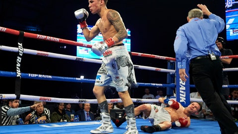 <p>               Oscar Valdez, left, celebrates after defeating Carmine Tommasone during the WBO featherweight title boxing match Saturday, Feb. 2, 2019, in Frisco, Texas. (AP Photo/Cooper Neill)             </p>