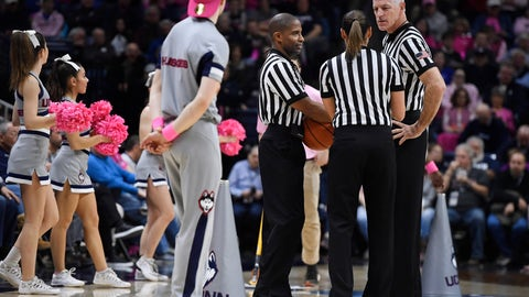 <p>               Referee Bruce Morris, right, officiates an NCAA college basketball game between Connecticut and Temple with Eric Brewton, left, and Tiara Cruse, center,, Saturday, Feb. 9, 2019, in Storrs, Conn. Morris holds an NCAA record for the longest shot recorded.(AP Photo/Jessica Hill)             </p>