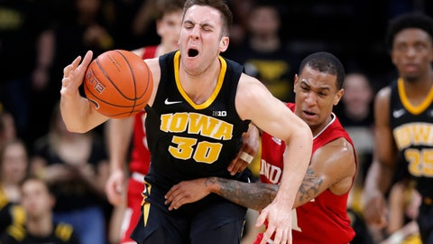 <p>               Iowa guard Connor McCaffery is fouled by Indiana guard Devonte Green, right, during the second half of an NCAA college basketball game Friday, Feb. 22, 2019, in Iowa City, Iowa. (AP Photo/Charlie Neibergall)             </p>