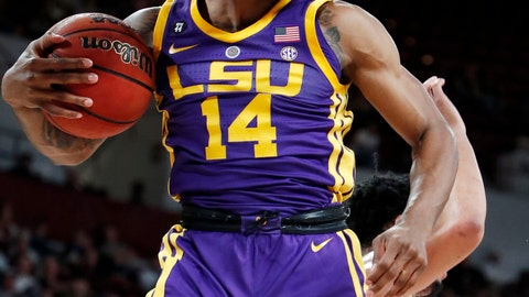<p>               LSU guard Marlon Taylor (14) pulls down a rebound during the first half of an NCAA college basketball game against Mississippi State in Starkville, Miss., Wednesday, Feb. 6, 2019. (AP Photo/Rogelio V. Solis)             </p>