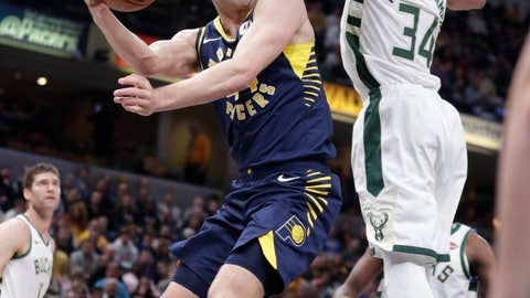 <p>               Indiana Pacers forward Bojan Bogdanovic (44) makes a pass around Milwaukee Bucks forward Giannis Antetokounmpo (34) during the first half of an NBA basketball game in Indianapolis, Wednesday, Feb. 13, 2019. (AP Photo/Michael Conroy)             </p>