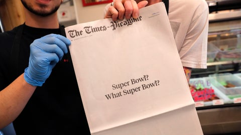"<p>               Brothers Damien Hanford, right, and Matthew Hanford, hold their copy of the mostly blank front page of the New Orleans Times-Picayune newspaper, at Bergeron Boudin and Cajun Meats, in Harahan, La., Monday, Feb. 4, 2019. The newspaper's nearly blank front page summarized what those in the Big Easy think of the New England Patriots' win over the Rams on Sunday: ""Super Bowl? What Super Bowl?"" (AP Photo/Gerald Herbert)             </p>"
