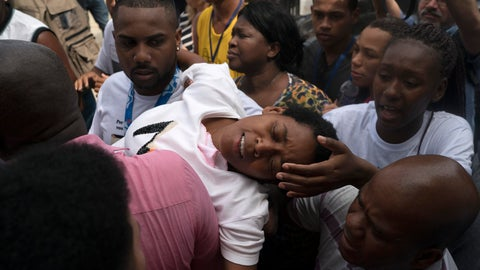 <p>               The mother of Samuel de Souza Rosa, one of the 10 young soccer players killed in a fire at the training ground of Brazilian soccer club Flamengo, is carried by mourners during his funeral in Sao Joao de Meriti, Brazil, Monday, Feb. 11, 2019. The death of de Souza Rosa and his teammates has shed a tragic light on the state of shoddy infrastructure and lax oversight in Latin America's largest nation. (AP Photo/Leo Correa)             </p>