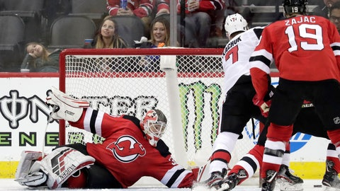 <p>               New Jersey Devils goaltender Cory Schneider, left, falls to the ice while reaching to defend against Ottawa Senators left wing Brady Tkachuk (7) during the second period of an NHL hockey game, Thursday, Feb. 21, 2019, in Newark, N.J. (AP Photo/Julio Cortez)             </p>