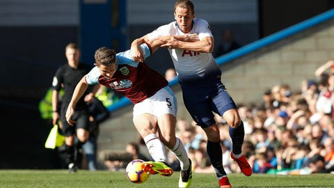 <p>               Tottenham Hotspur's Harry Kane, right, and Burnley's James Tarkowski during their English Premier League soccer match at Turf Moor in  Burnley, England, Saturday Feb. 23, 2019. (Martin Rickett/PA via AP)             </p>