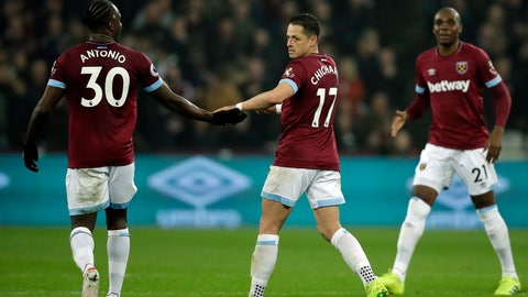 <p>               West Ham's Chicaharito, center, celebrates with West Ham's Michail Antonio, left, after scoring his side's opening goal during the English Premier League soccer match between West Ham and Fulham at the London Stadium in London, Friday, Feb. 22, 2019. (AP Photo/Matt Dunham)             </p>