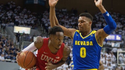 <p>               UNLV guard Kris Clyburn (1) drives on Nevada forward Tre'Shawn Thurman (0) during the first half of an NCAA college basketball game in Reno, Nev., Wednesday, Feb. 27, 2019. (AP Photo/Tom R. Smedes)             </p>