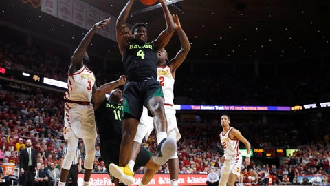 <p>               Baylor guard Mario Kegler, center, pulls down a rebound during the second half of the team's NCAA college basketball game against Iowa State, Tuesday, Feb. 19, 2019, in Ames, Iowa. Baylor won 73-69. (AP Photo/Matthew Putney)             </p>