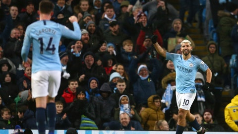 <p>               Manchester City's Sergio Aguero, right, celebrates after scoring his side's third goal during the English Premier League soccer match between Manchester City and Arsenal at Etihad stadium in Manchester, England, Sunday, Feb. 3, 2019. (AP Photo/Dave Thompson)             </p>